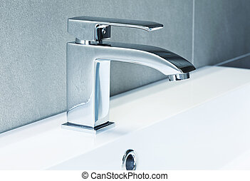 modern tap - modern ta in bathroom closeup image