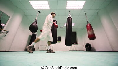 man in gloves makes some final training session of boxing...
