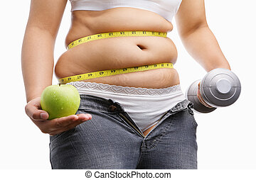 fat woman with unzup jeans holding apple and weight on each...