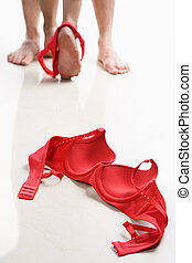 Couple having intercourse with red bra on floor, I use red...