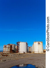 Gas tanks under the blue sky