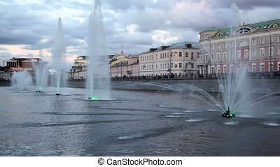 Fountains with illumination in Obvodnoy channel at evening