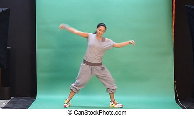 Young woman dancing in action