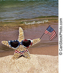 Patriotic Starfish - Starfish with American flag on a beach.