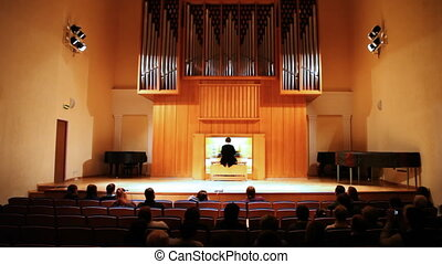 People listen organ concert MUSIC NOT COPYRIGHTED performed...
