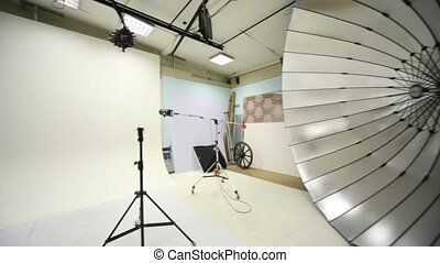 White background inside studio light room with lamps and spotlights