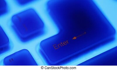 Several buttons of keybord with blue backlight rotates in...