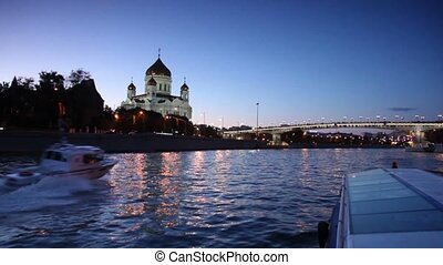 Ship sail down the river, cutter surpass it, Christ Savior Cathedral and Patriarchal Bridge