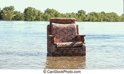 The restless chair in the river