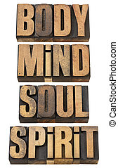 body, mind, soull and spirit in wood type