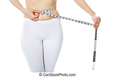 Woman measuring her abdomen
