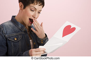 Note Card - Girl reads a Valentine's Day Card