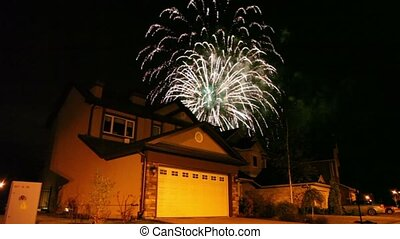Fireworks at dark sky over house in cottage village