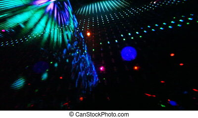 large LED screen with changing picture in nightclub