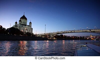 Ship sail down the river, Christ Savior Cathedral and Patriarchal Bridge at evening