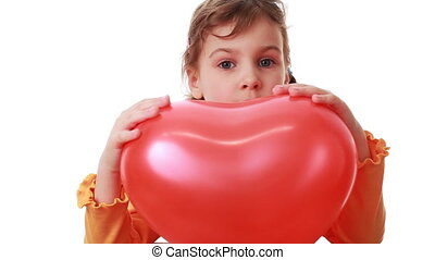 little girl hold big heart shaped balloon and then she release it