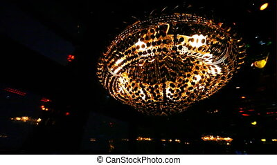 chandelier and wall of monitors rhythmically flashing...