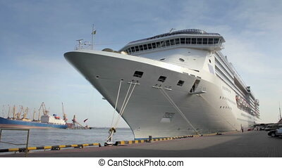 White cruise liner at sea port