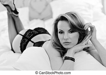 Boudoir Portraiture - Young gorgeous blond woman in sexy...