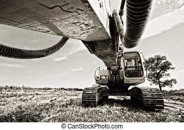 backhoe - Excavator standing in a field ready for work