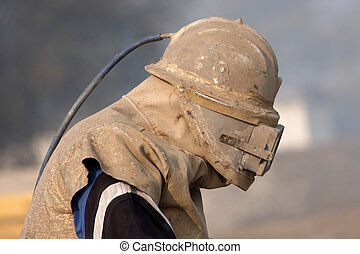 sandblasting - Man with a mask for sandblasting