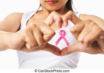 Heart framing from fingers on woman chest with pink badge to...