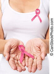 Woman showing pink ribbon to support breast cancer cause. PS...