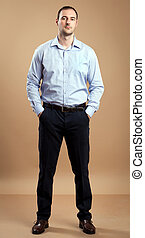 Business Man - Man wearing business outfit standing relaxed...