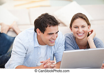 Young Couple watching a computer indoors