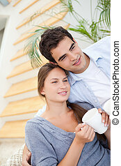 Young Couple smiling while embracing each other