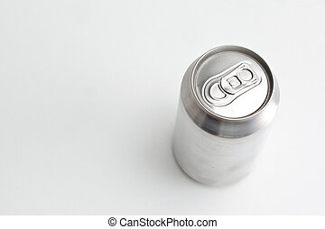 High angle view of a closed aluminium can against a white...
