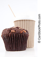 Chocolate muffin and a cup of coffee placed together against...
