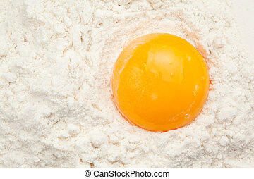 Egg yolk on the flour in a high angle view