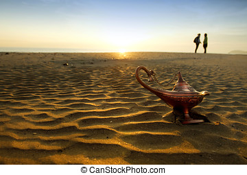 Magic lamp at sunrise on the beach