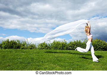 Woman running with white scarf