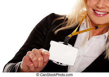 Businesswoman holding up her blank ID tag