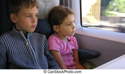 Little girl and boy travel by fast train, time lapse