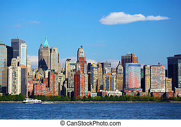 Lower Manhattan with Battery Park over Hudson River, New...