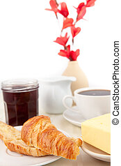 Table presentation for a breakfast against white background