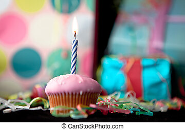 Birthday cup cake on a black table