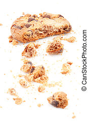 Close up of an half eaten cookie against a white background