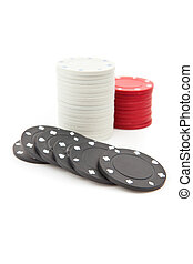 Poker tokens piled up together against a white background