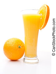 Orange near a glass of orange juice