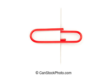 Close up of a red paperclip attaching on a white paper...
