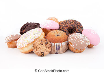 Cakes laid out together against a white background