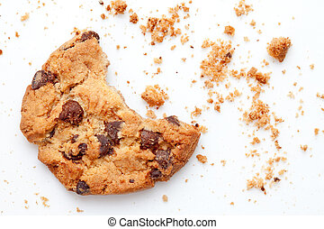 Close up of an half eaten cookie with crumb against a white...