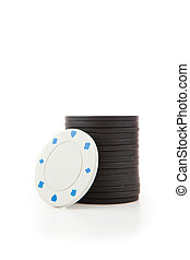 Black and white poker tokens against a white background