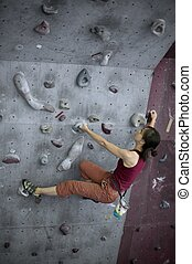 Woman doing the bouldering - A girl doing her bouldering...