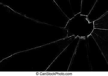 Crackled and broken glass against a black background