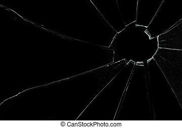 Crackled and broken glass against a black background